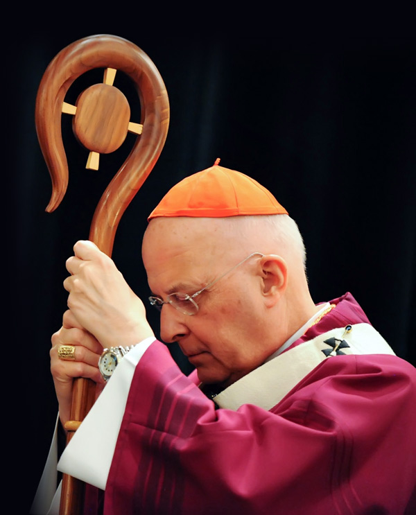 Cardinal George listens to the reading of the Gospel with head bowed while holding his crosier during Mass at the 2011 Chicago Catholic Men's Conference
